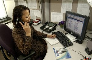 17341-an-african-american-woman-working-at-her-desk-pv